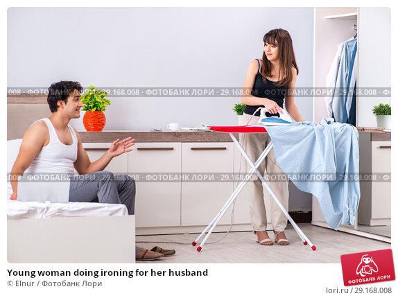Купить «Young woman doing ironing for her husband», фото № 29168008, снято 27 июня 2018 г. (c) Elnur / Фотобанк Лори
