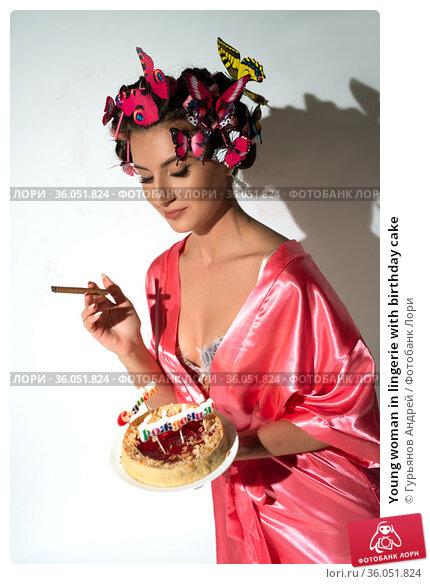 Young woman in lingerie with birthday cake. Стоковое фото, фотограф Гурьянов Андрей / Фотобанк Лори