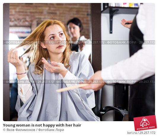 Купить «Young woman is not happy with her hair», фото № 29257172, снято 7 марта 2017 г. (c) Яков Филимонов / Фотобанк Лори