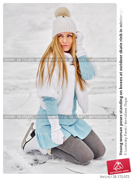 Купить «Young woman poses standing on knees at outdoor skate rink in winter park», фото № 28172072, снято 19 января 2016 г. (c) Losevsky Pavel / Фотобанк Лори