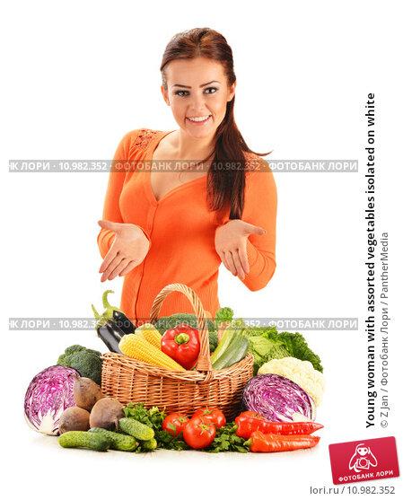 Купить «Young woman with assorted vegetables isolated on white», фото № 10982352, снято 18 апреля 2018 г. (c) PantherMedia / Фотобанк Лори