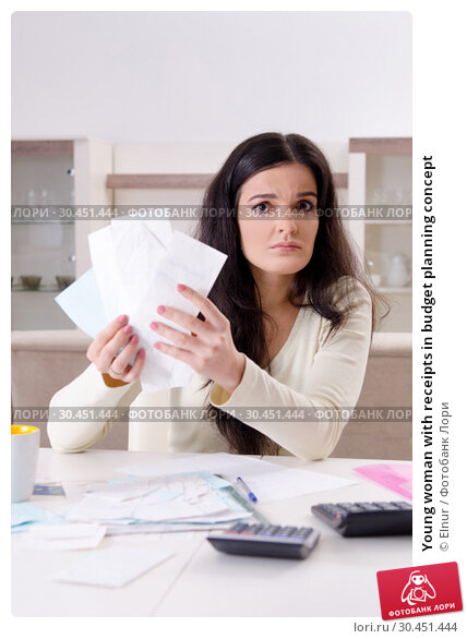 Young woman with receipts in budget planning concept. Стоковое фото, фотограф Elnur / Фотобанк Лори