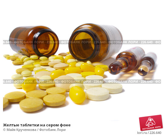 Желтые таблетки на сером фоне, фото № 226640, снято 23 января 2008 г. (c) Майя Крученкова / Фотобанк Лори